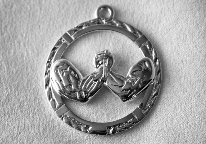 AWC Classic Arm Wrestling Pendant - Silver on white cloth
